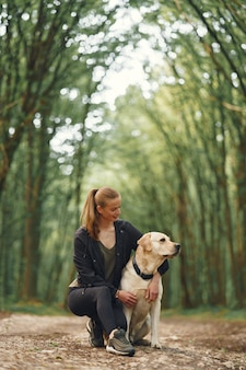 Portrait of a woman with her beautiful dog