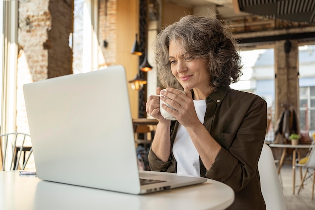 Portrait woman with laptop working