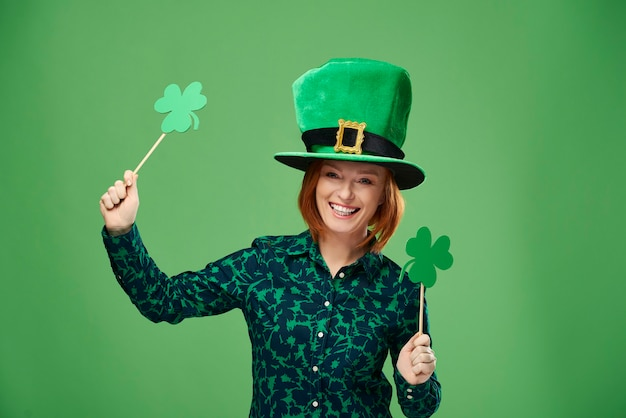 Portrait of woman with leprechaun's hat and clover shaped banner