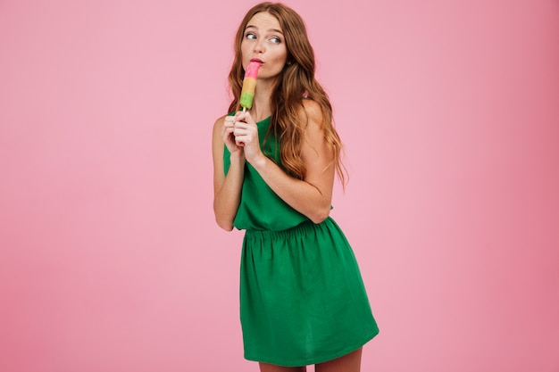 Portrait of a woman with long hair licking ice cream