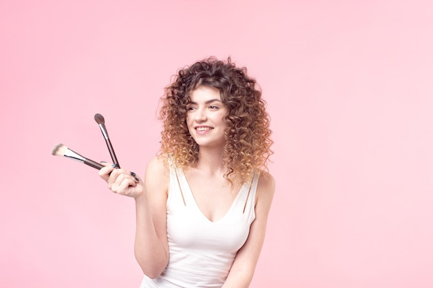 Portrait woman with make up brushes