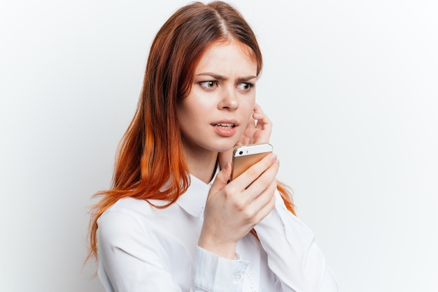 Portrait of a woman with a phone in her hands