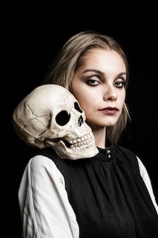Portrait of woman with skull on shoulder