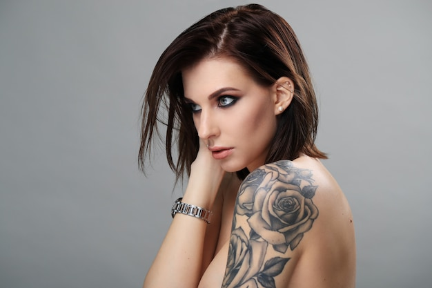 Portrait of woman with tattoo