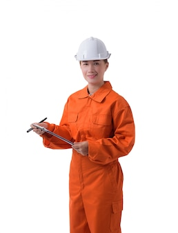Portrait of a woman worker in mechanic jumpsuit is holding clipboard and pen