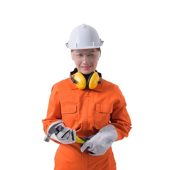Portrait of a woman worker in mechanic jumpsuit is holding hammer isolated on white background