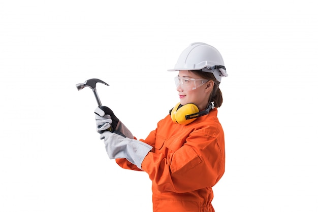 Portrait woman worker in mechanic jumpsuit is holding hammer isolated white