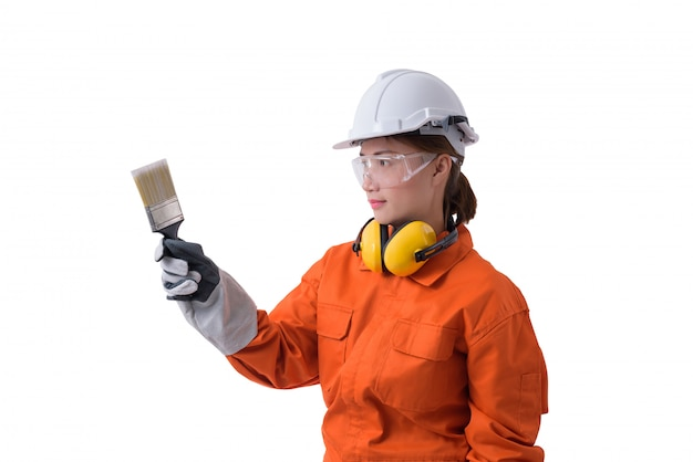Portrait of a woman worker in mechanic jumpsuit is holding paint brush isolated on white background