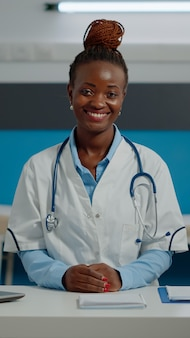 Portrait of woman working as medic in office at healthcare clinic