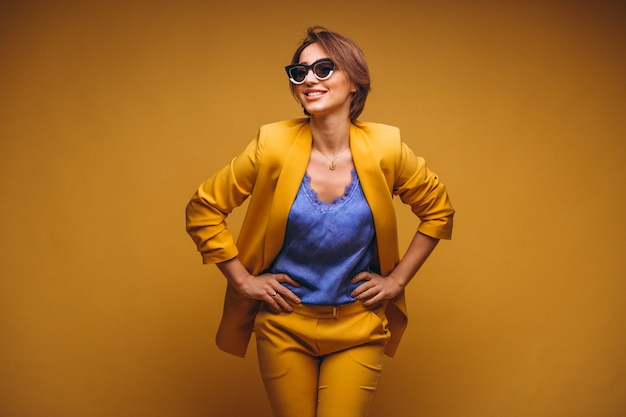 Portrait of woman in yellow suit isolated