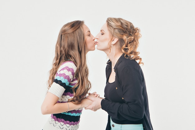 Portrait of women kissing