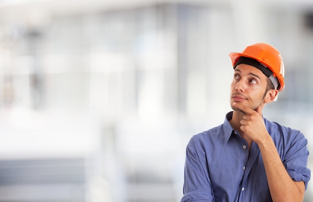Portrait of a worker looking at the white copy-space