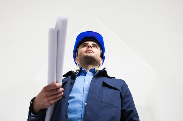 Portrait of a worker in a white room