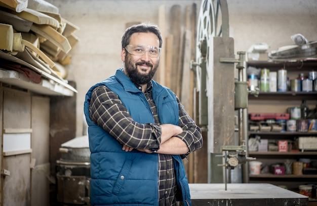 Portrait of workshop crafts man indoors