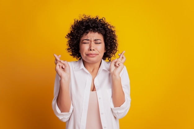 Portrait of worried woman pointing fingers empty space advise novelty on yellow background