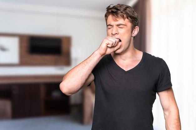 Portrait of yawning man