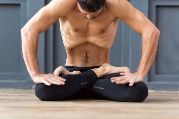 Portrait of yogi men doing abs exercise