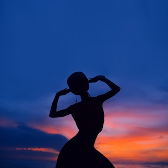 Portrait of yong dancing girl at sunset
