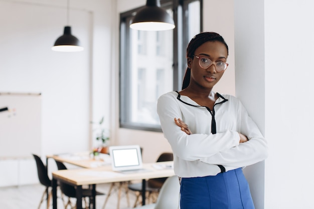 Portrait of a young african american business woman in modern loft office