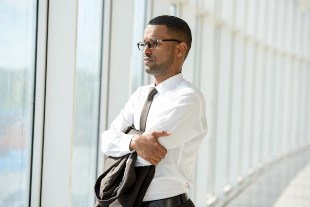 Portrait of young african businessman in office center.
