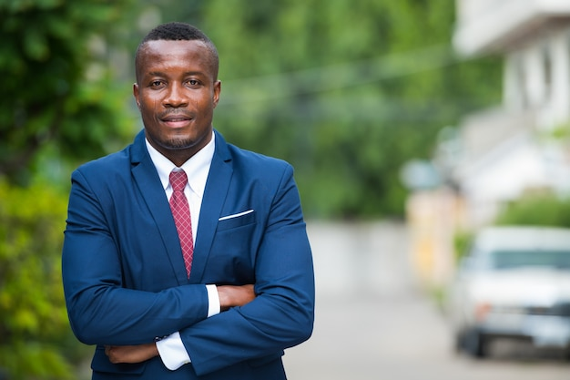 Portrait of young african businessman in the streets outdoors