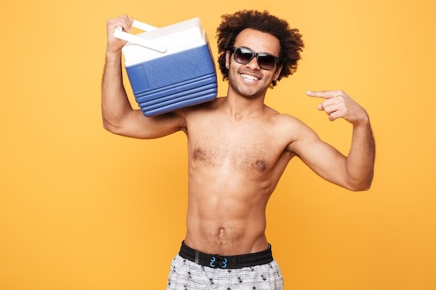 Portrait of a young afro american man in summer shorts