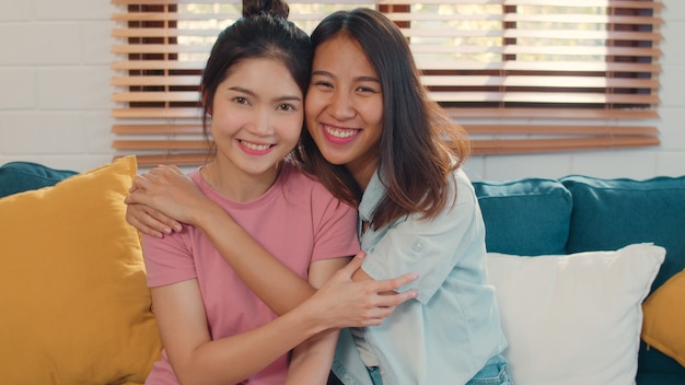 Portrait young asia lesbian lgbtq women couple feeling happy smiling at home.