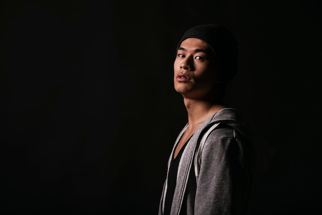 Portrait of young asian boy with casual wear. challenging attitude.