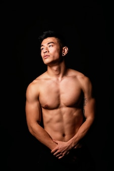 Portrait of young asian boy with fitness body. challenging attitude