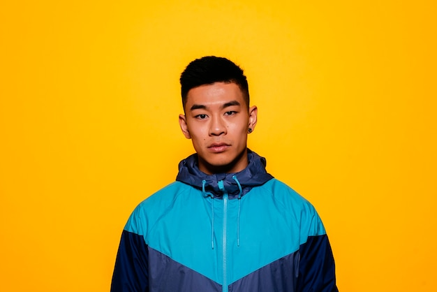 Portrait of young asian boy with sportswear. challenging attitude.