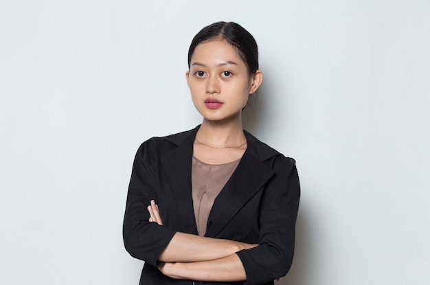 Portrait young asian  business woman smile with arms crossed