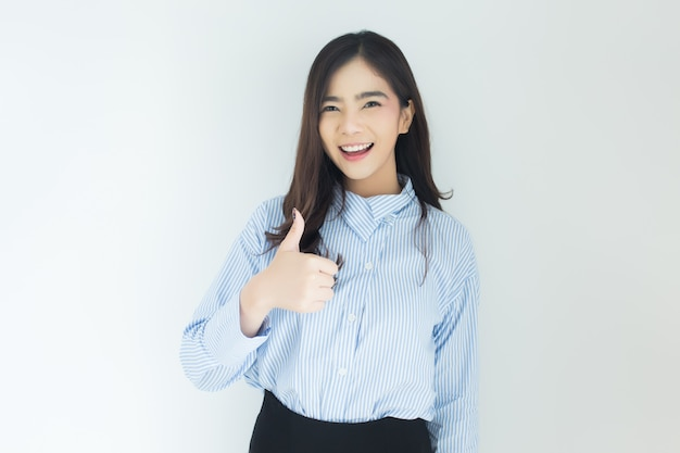 Portrait of young asian business woman thumbs up very good symbol on white background.