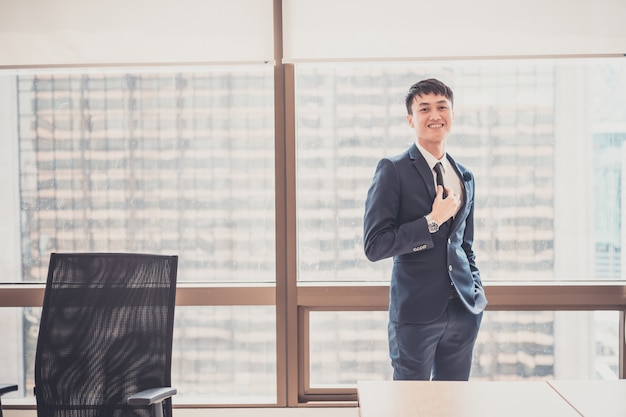 Portrait of young asian businessman  in modern office concept for business