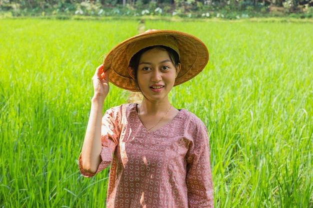 Portrait young asian female farmer in rice field