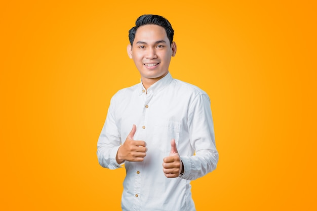 Portrait of young asian man giving double thumb up
