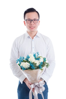 Portrait of young asian man holding flowers