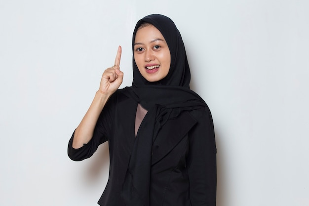 Portrait of a young asian muslim woman thinking idea