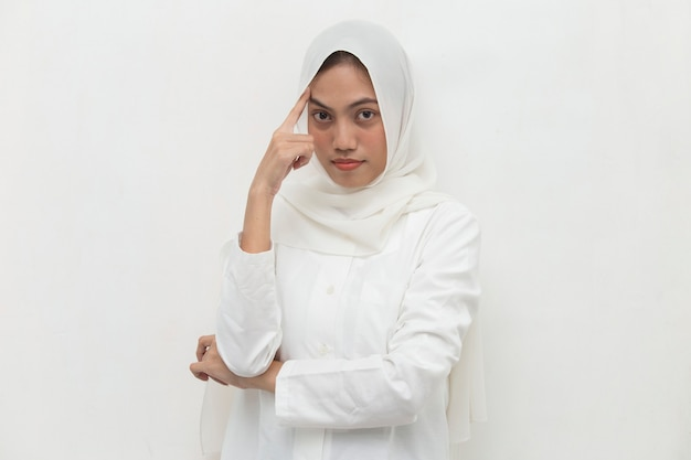 Portrait of a young asian muslim woman thinks