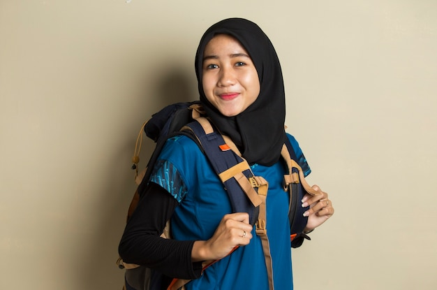 Portrait of young asian muslim woman traveler smile