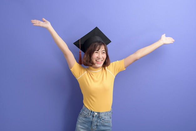 A portrait of young asian student wearing graduation cap.