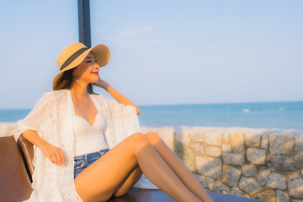 Portrait young asian woman happy smile relax around beach sea ocean