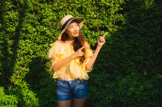 Portrait young asian woman happy smile relax around outdoor nature garden