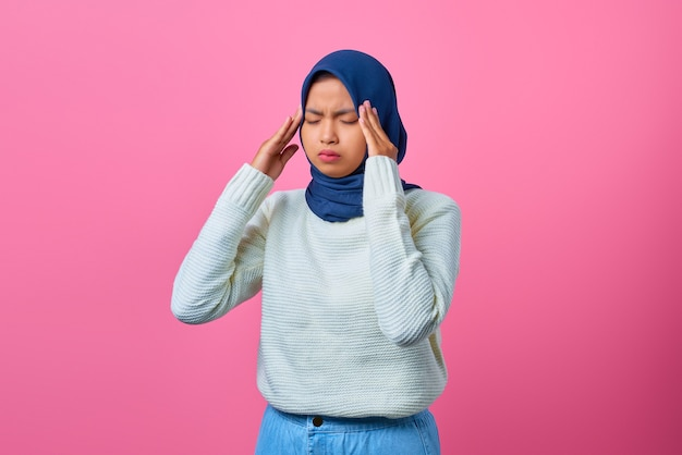 Portrait of young asian woman looking dizzy and having headache