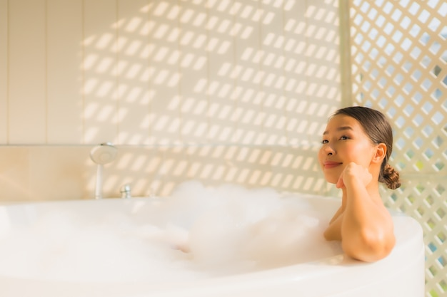 Portrait young asian woman relax take a bath in bathtub