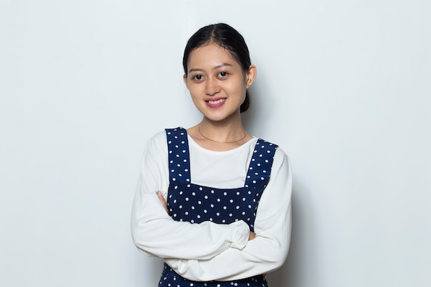 Portrait young asian woman smile with arms crossed