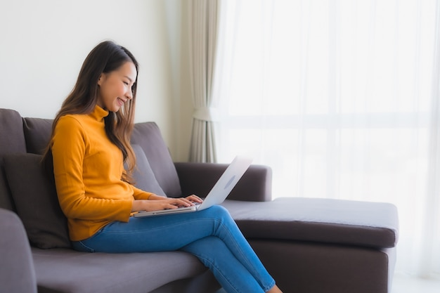 Portrait young asian woman using laptop computer note book on sofa