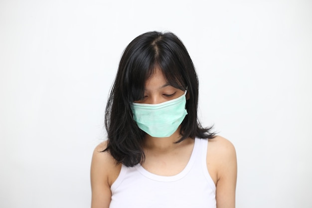 Portrait of young asian woman wearing a face mask, isolated. protection against virus. Premium Photo