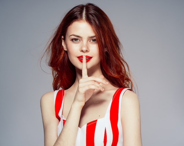 Portrait of a young attractive and beautiful woman with red lips