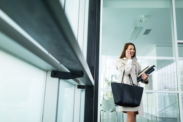 Portrait of young attractive businesswoman going to office