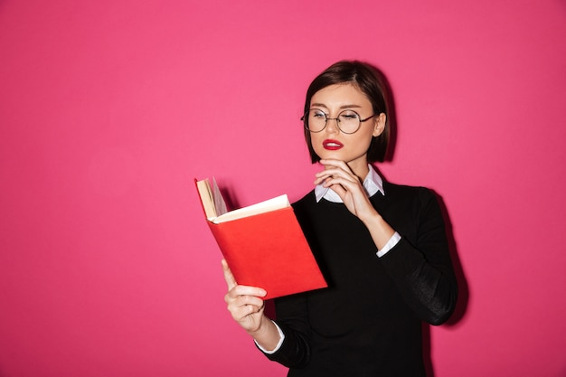 Portrait of a young attractive businesswoman  reading a book